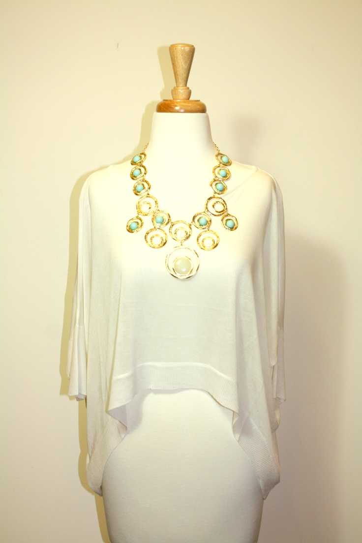 A flowy white top goes great with one of our statement necklaces!