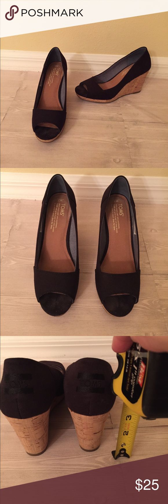 TOMS Black Wedges Size 7 TOMS Black Wedges Size 7. Good used condition. Wedge height in pics. Only signs of wear are on the sole and a little faintness in the bottom where your toe would be, see pic. Box not included. Toms Shoes Wedges