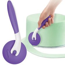 This tool comes in handy when you are working with fondant.  It helps you trim off the excess.