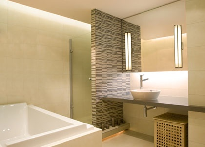 bathroom makeup lighting. cove sconce lighting in a bathroom ensures enough light for makeup application etc