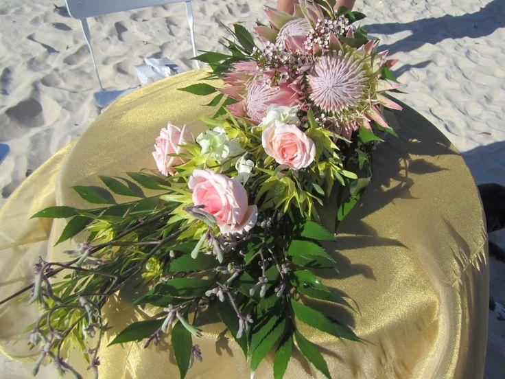 Natalie carried a beautiful native Australian floral bouquet when she married Kahl on Rainbow Beach.