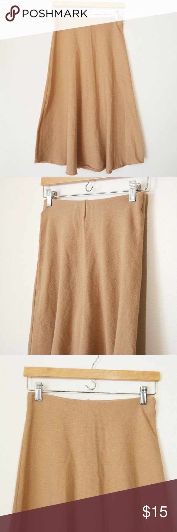 """Zara Brown A Line Midi Skirt In great condition. Comes with elastic waistband and raw hem.  The color of the skirt is slightly on the more blush tone of brown. Very feminine and minimal.  Waist: 26"""" Length: 29"""" Zara Skirts Midi"""