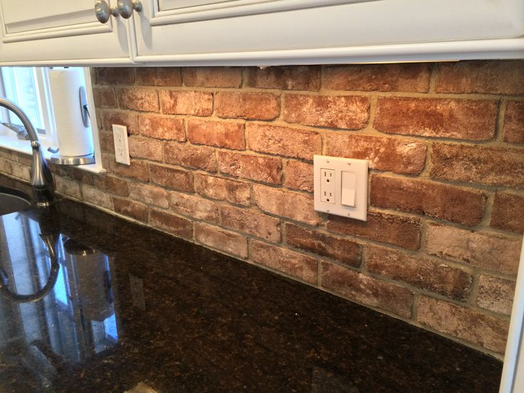 thin brick kitchen backsplash closeup view of grey backsplash installation 6097