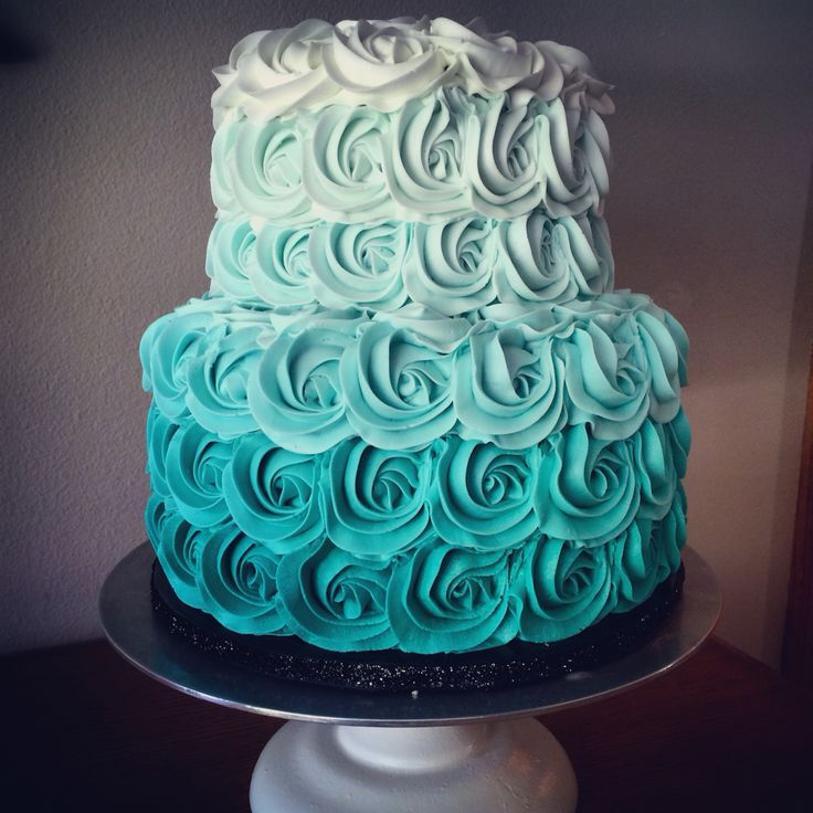 Two-tiered vanilla buttercream teal ombré cake.