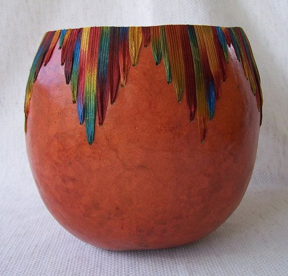 Large orange bowl, rich color variegated acrylic ribbon sewn in Vs all around. 1604.