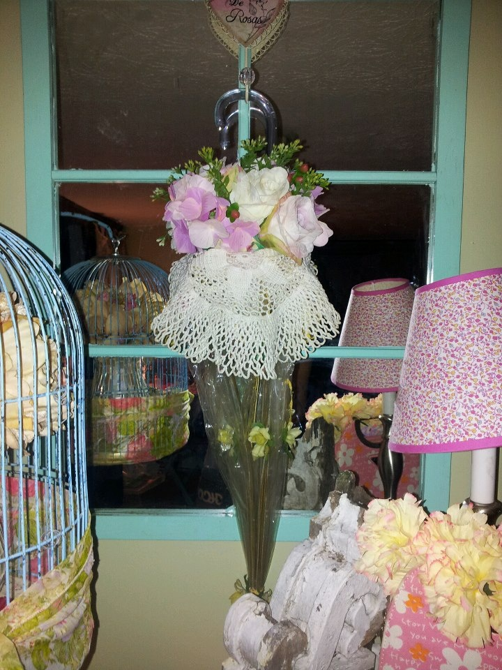 upcycle an old umbrella!!! hand on a mirror like i did or hang on your front door for a fresh spring look! Looks adorable with tulips!