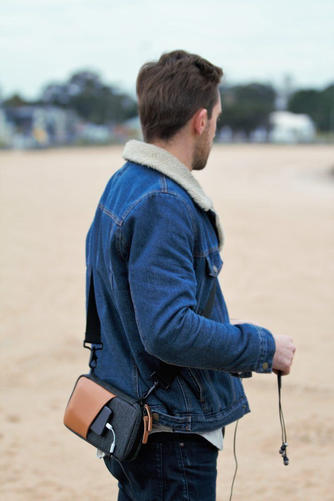 Man standing with Etchr Field Case with headphones