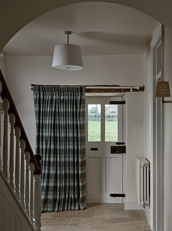 Entrance Hall designed by Sims Hilditch for Converted English Farmhouse project. ©️️ How to keep the cold air from your front door out of your hall.  Hang a thick curtain which can be pulled shut over the door.