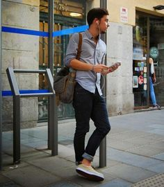 Men's street fashion. Rolled jeans, grey button down, loafers, and messenger bag. Great easy look.