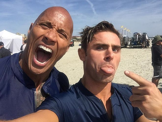 """8 Reasons the Baywatch Cast Is Having the Most Fun Ever on Set   1. THEY CAN'T HELP BUT MAKE GOOFY FACES   The cast of Baywatch may be comprised of a team of actors, but one look through their Instagram accounts, and you'd swear they were all comedians. Plus, we can't help but fall for the new bromance that is Zac Efron and Dwayne """"The Rock"""" Johnson. So cute."""