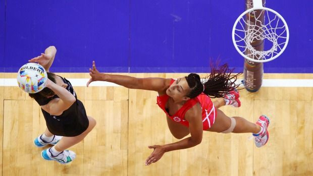 Geva Mentor of England defends against Bailey Mes during the Silver Ferns' comprehensive Netball World Cup semifinal ...