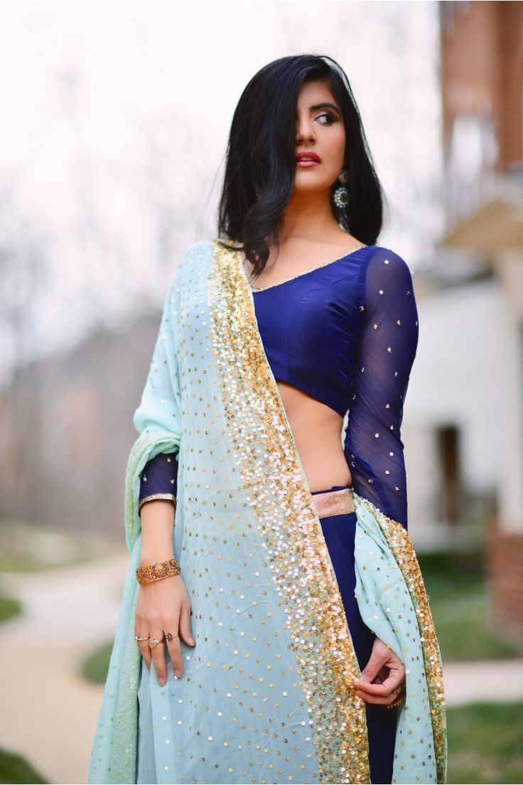bisouNYC - Serena >> Sapphire blue lehenga and crop top with gold embellishments paired with teal dupatta heavily embellished with gold sequin