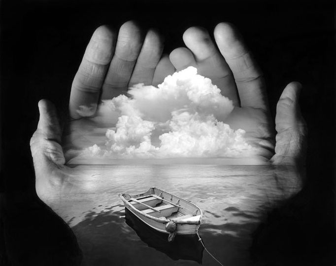 Untitled, (Rowboat, ocean and clouds in cupped hands), 1996 | Jerry Uelsmann - Jerry Uelsmann is a pioneer of surreal photography. He began assembling photographs from multiple negatives decades before digital tools like Photoshop were available. Back in the day, he was even friends with legendary nature photographer Ansel Adams and taught workshops with him in Yosemite for years.