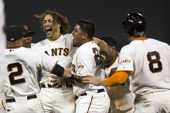 Michael Morse #38 of the San Francisco Giants is congratulated by teammates after hitting a walk off RBI single against the New York Mets during the ninth inning at AT&T Park on June 7, 2014 in San Francisco, California. The San Francisco Giants defeated the New York Mets 5-4.