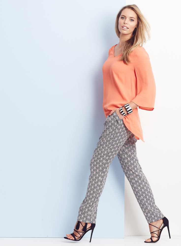 """OFFICE TO EVENING / Simplify your day with effortless office to drinks looks. Elegant bell sleeves transforms the essential blouse - team with print pants for an added """"wow"""" factor."""