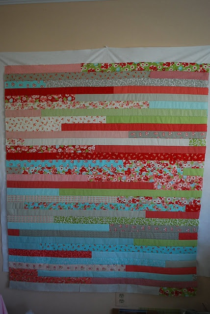 "jelly roll race quilt! VERY VERY QUICK quilt (takes a couple of hours.) one jelly roll or 40 strips that are 2 1/2"" x 40″, scissors, thread, one full bobbin of Aurifil thread and one iron.    Shuffle jelly roll strips to mix up the colors. Most pre-selected jelly rolls roll like colors together. For this quilt, the outcome will look better with a randomized order."