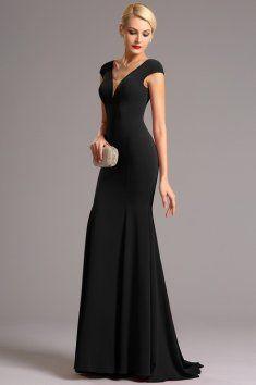 Vysoce elegantní plesové šaty černé hluboký výstřih na přední i zadní straně minirukávky zakrývající ramena            šaty mají projmutý střih a všitou podprsenku materiál: mírně pružný samet délka 155 cm