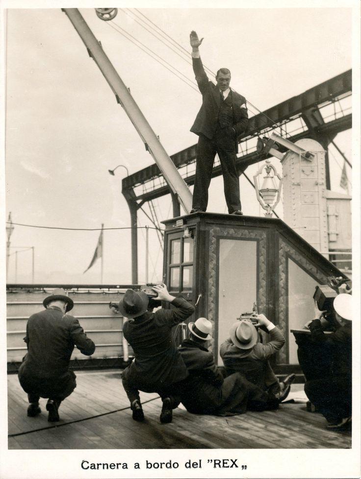 """Primo Carnera, campione mondiale dei pesi massimi, posa per i fotografi a bordo del """"Rex"""". Primo Carnera, World Heavyweight Champion 1933-1934, poses on board """"Rex"""". (Photo: Achille Testa, 1932-1936). #transatlantici #piroscafi #transatlantics #steamships #Rex #PrimoCarnera"""