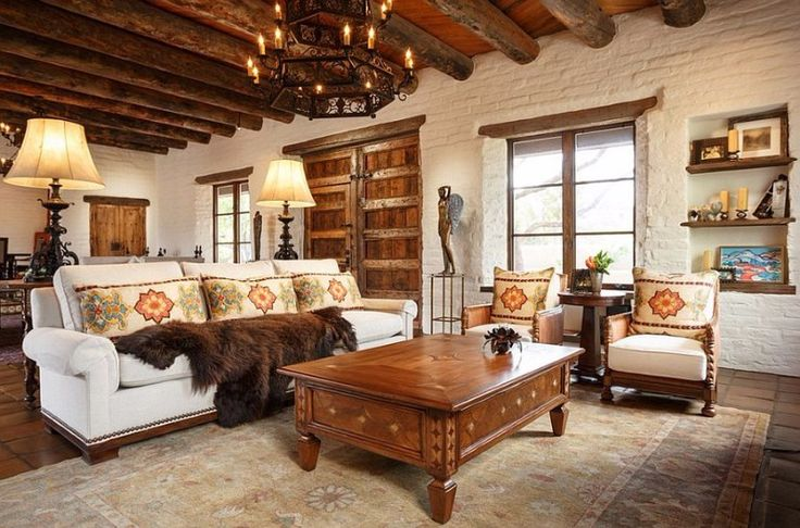 From+the+candle+light+chandelier+to+the+sculpted+angel+and+the+fur+coat+sitting+on+the+sofa,+this+interior+décor+screams+Southwestern+décor+from+a+mile+away.