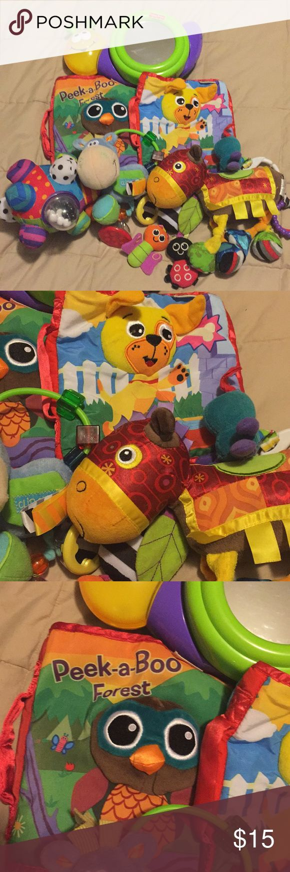 Bundle of baby toys! Lamaze, Fisher Price, Sassy Light up Fisher Price Snail with Mirror, Lamaze Washable Fabric Books X2 and More. See pictures for all items included Other