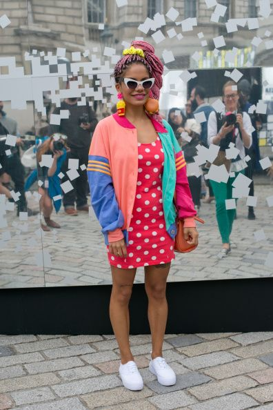 Fashion Blogger Maga Moura is wearing a vintage jacket Forever 21 dress Primark shoes and Bitsch Kitsch earrings on day 2 of London Collections Women...