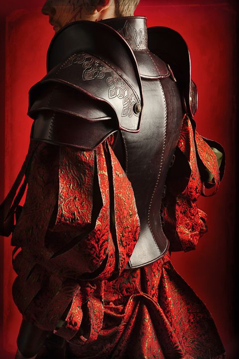 Steel plate-armour shapes translated into boiled-leather armour.