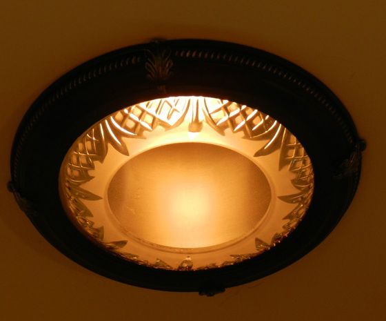 Here is an inexpensive way to dress up recessed lights.  Easy to install and find at Home Depot