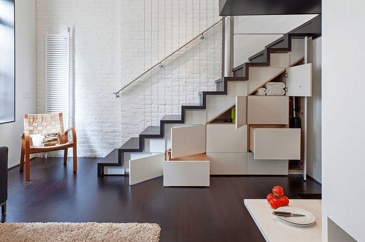Deep White Drawers Under Dark Stairs - Install deep drawers to take full advantage of a typically unused space