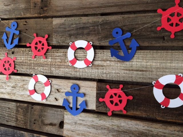 Nautical Party Garland - Nautical Decor, Nautical Baby Shower, Anchor, Life Ring, Ship Wheel Under the Sea, Photo Prop by BlueOakCreations on Etsy https://www.etsy.com/listing/244000883/nautical-party-garland-nautical-decor