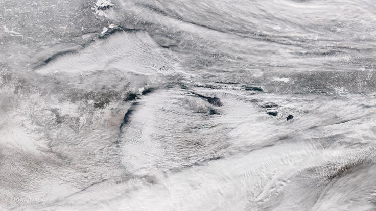 A stunning true-color satellite image taken yesterday shows the Great Lakes shrouded by lake-effect snow clouds. It's a glorious example of this meteorological phenomenon in action.