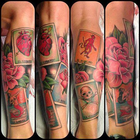 This elaborate tattoo features five of the most revered loteria cards: el corazon, la sirena, la rosa, el diablito and la calavera.