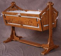 cute baby cradle, I like them old school, wood.  Awesome.