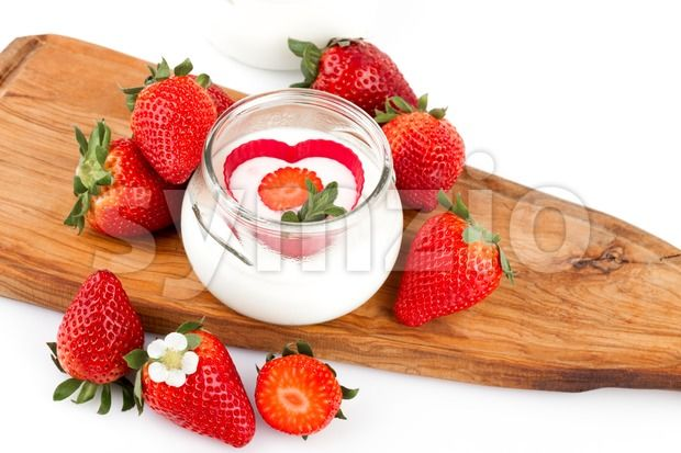 Stock photo of Strawberries Yogurt from $1.99. Strawberries Yogurt - Jar with yogurt decorated with fresh strawberries....