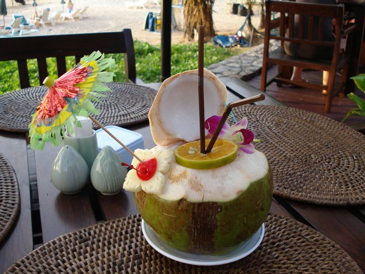 Early evening Pina colada drink in fresh coconut shell