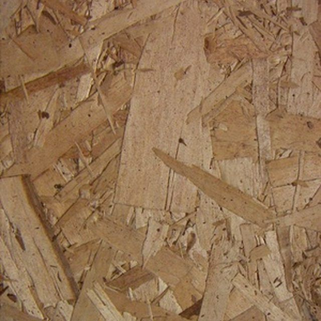 Paint chipboard subfloors to give them a finished appearance.