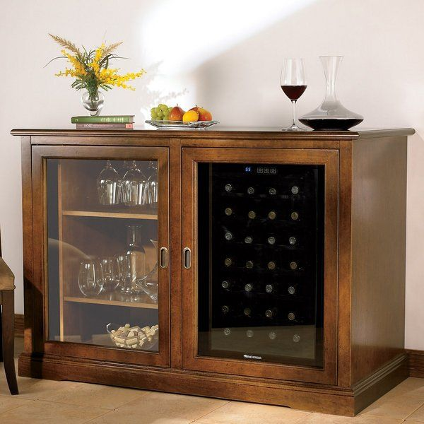 """Let impassioned Italian design steal your heart. Leave it to Italy's finest craftsmen to make you fall in love with furniture. This premium-quality wine credenza is handmade from tulip and walnut hardwoods, then hand-stained patina applications. <br/>Accommodates a 28-Bottle Touchscreen Wine Refrigerator (sold separately)<br/>The Siena Mezzo (mezzo meaning """"half"""" in Italian) is roughly half the size of the original Siena Wine Credenza."""