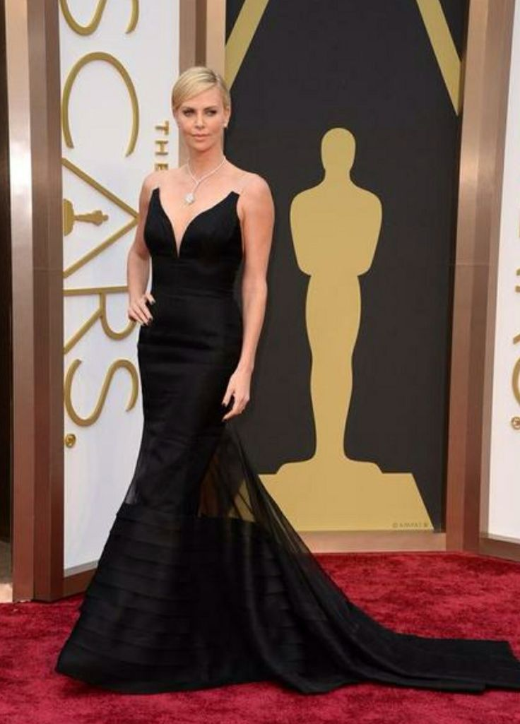 Charlize Theron looking fab! Love the shape of this dress.