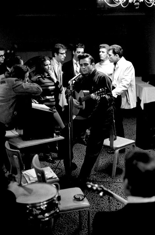 Johnny Cash surrounded by The Statler Brothers