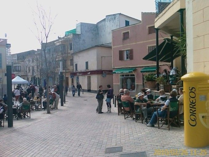 Majorca, Son Servera town square visitors relaxing during market day