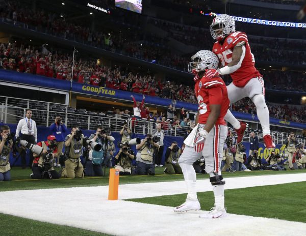 Dec 29, 2017; Arlington, TX, USA; Ohio State Buckeyes quarterback J.T. Barrett (16) celebrates with running back Mike Weber (25) after scoring a touchdown during the second quarter against the USC Trojans in the 2017 Cotton Bowl at AT&T Stadium. Mandatory Credit: Kevin Jairaj-USA TODAY Sports