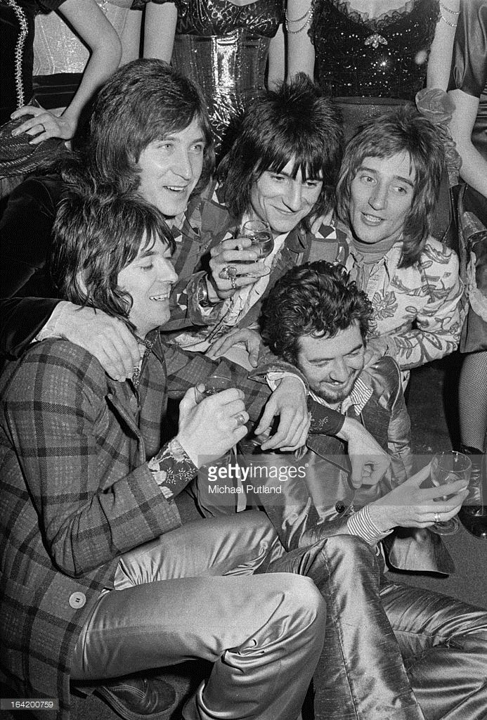 English rock group Faces at a reception at the Tramp nightclub in London for the release of their album 'Ooh La La', 5th April 1973. Clockwise, from bottom, left: keyboard player Ian McLagan, drummer Kenney Jones, guitarist Ronnie Wood, singer Rod Stewart and bassist Ronnie Lane (1946 - 1997).