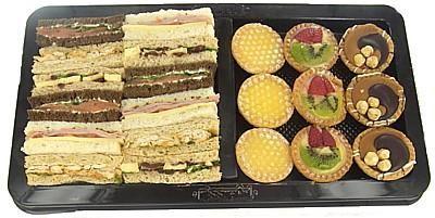 Combo Ribbon Sandwich & Tart Platter Cajun Chicken / Ham, Swiss Cheese & tomato / Smoked Salmon / Camembert & Cranberry PLUS Zesty Lemon, Fruit and Hazelnut Choc Petit Tarts
