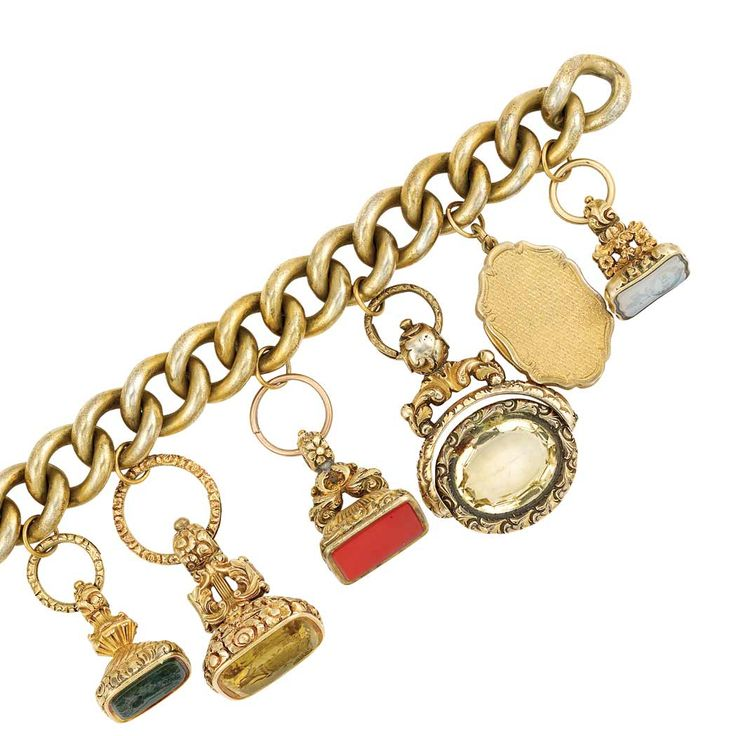 Antique Silver Gilt, Gold, Hardstone and Gem-Set Fob Charm Bracelet   Composed of interlocking silver gilt oval links supporting five fobs set with a bloodstone intaglio, a citrine intaglio, citrine, a chalcedony intaglio, and a silver gilt vinaigrette charm. Length 7 9/16 inches.     CEstate of Harriett B. Anthony