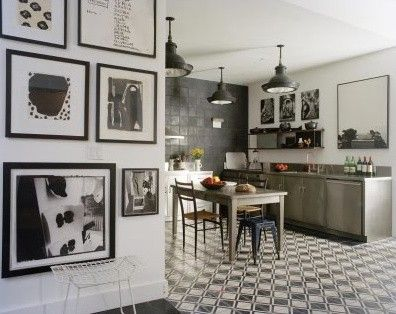 Hand made 100 year old Spanish tile. Thoughtful collection of black and white art.