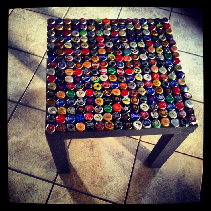 Beer bottle cap table- line edges with cardboard and pour epoxy resin over caps