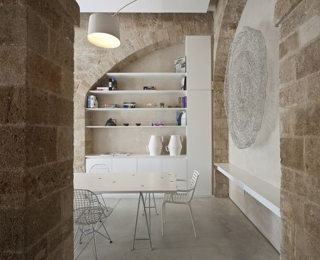 Modern Dining Room by Pitsou Kedem Architect. Install shelves in nooks and archways where pieces of furniture will not fit.