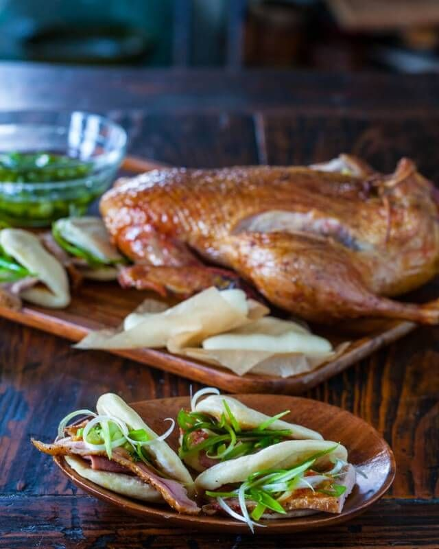 Smoked Duck with Chinese Steamed Buns - a classic that you'll love making at home with scallions, ginger, garlic, and plum sauce. | Steamy Kitchen Recipes