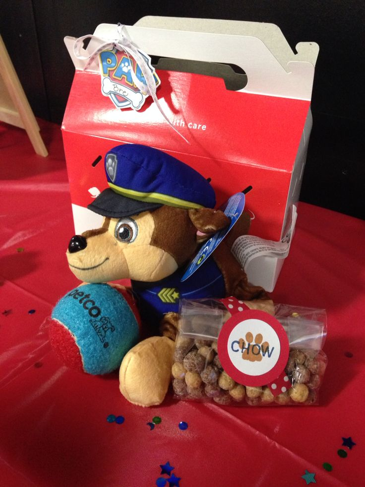 Paw Patrol Party Favor. Adopt a puppy. Petco pet adoption carrier and ball, Paw Patrol plush toy, and Reese's Pieces Puffs cereal for puppy chow.