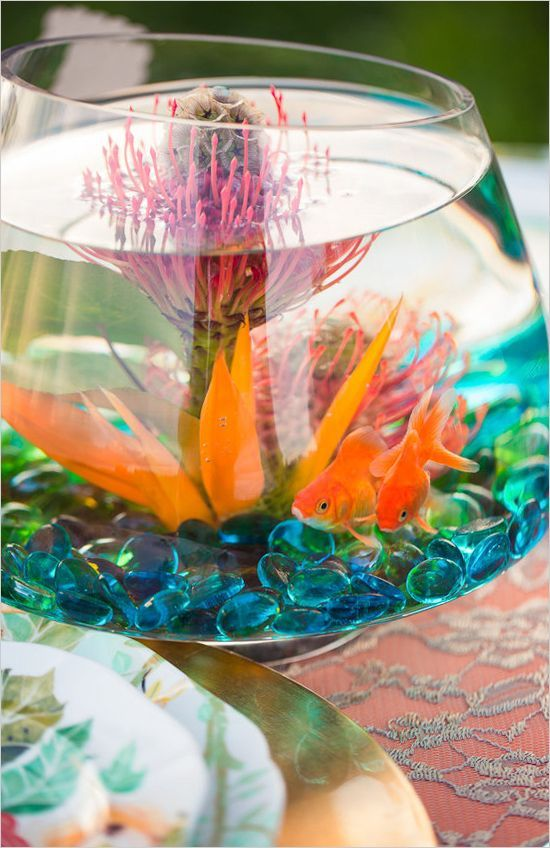 What a unique and colorful wedding centerpiece! #fishbowl #weddingreception #weddingchicks Design: Just For You Photography & Picture That Photography ---> http://www.weddingchicks.com/2014/04/30/colorful-bohemian-wedding-ideas/