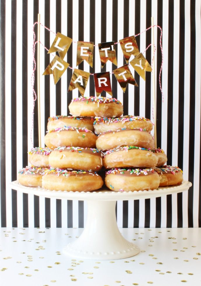 """Birthday Cake made easy! Stack donuts for easy party prep and easy serving! Everyone loves donuts! Make this DIY Gold Foil """"Let's Party"""" Banner to finish it off right! - Click for tutorial - www.classyclutter.net #hsminc #foilallthethings"""